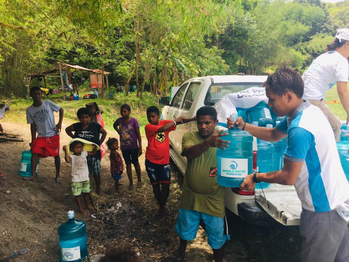 95 families from Brgy. Diaz who have transferred to a lower terrain for fear of aftershocks receiving much needed water from Manila Water Foundation