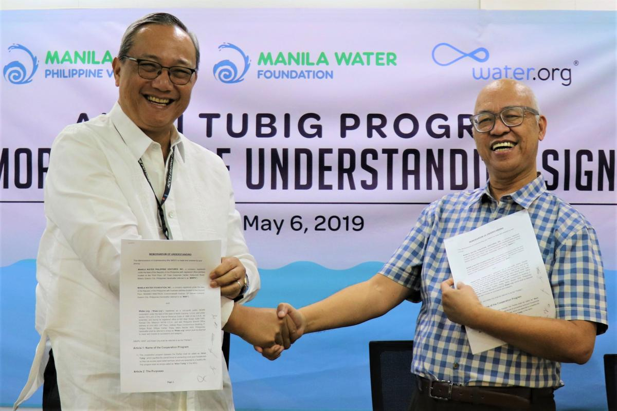 IN PHOTO : MWPV President Mr. Virgilio Rivera (Left) and  Water.org Philippines Country Director Mr. Carlos Ani (Right) shake hands to signify a three-year cooperation arrangement among the parties to support indigent households in having access to clean and safe water services.